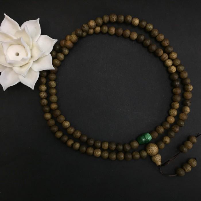 Vòng tay - chuỗi trầm hương 15 năm, cho size tay nữ (size tay 14~15.5 cm), dạng hạt tròn: 108 hạt x 6.5 mm, phối charm Lu Thống đá xanh - 1