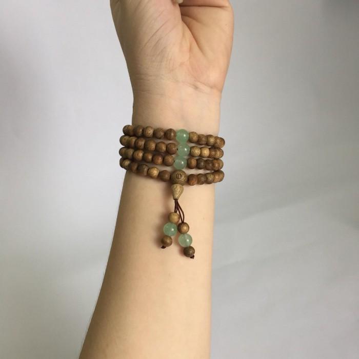 Vòng tay - chuỗi trầm hương 15 năm, cho size tay nữ (size tay 14~15,5cm), dạng hạt tròn: 108 hạt x 6.5 mm, phối đá xanh - 6