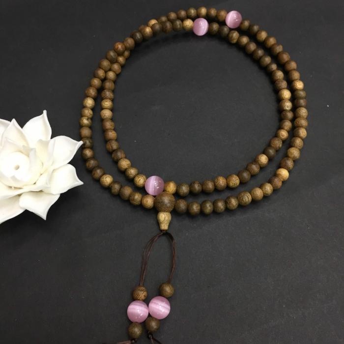 Vòng trầm hương 12 năm, cho nữ (size tay 14~15.5 cm), dạng hạt tròn: 108 hạt x 6.5 mm , phối charm đá hồng