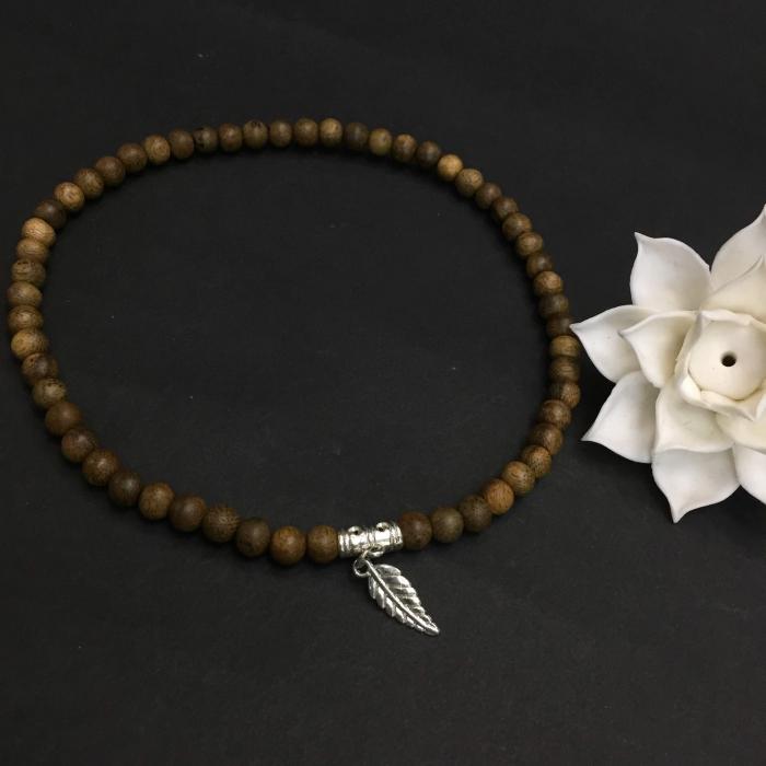 Vòng đôi trầm hương 15 năm, cho nữ (size tay 14~15.5 cm),, dạng hạt tròn: 54 hạt x 8 mm, phối charm lá (mạ bạc)