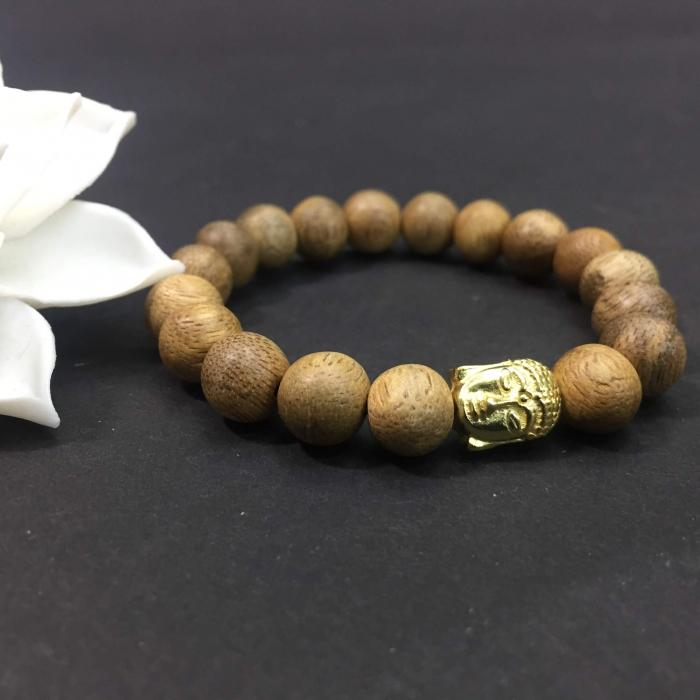 vòng trầm hương 12 năm, cho nữ( size tay 14~ 15.5 cm),dạng hạt tròn: 18 hạt x 8 mm, charm Mặt Phật Vàng (bạc 925)