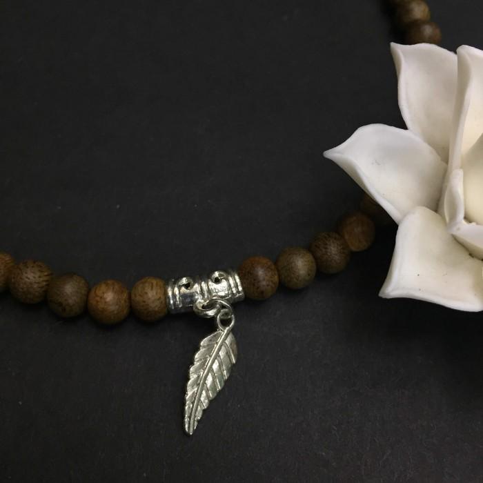 Vòng tay - Vòng đôi trầm hương 15 năm, cho nữ (size tay 14~15.5 cm),, dạng hạt tròn: 54 hạt x 8 mm, phối charm lá (mạ bạc) - 2