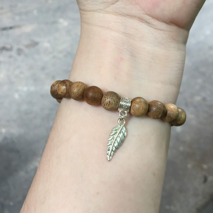 Vòng tay - Vòng đôi trầm hương 15 năm, cho nữ (size tay 14~15.5 cm),, dạng hạt tròn: 54 hạt x 8 mm, phối charm lá (mạ bạc) - 4