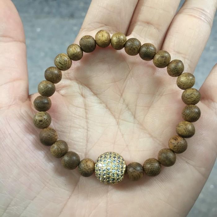 Vòng tay - vòng trầm hương 15 năm, cho size tay nữ (size tay 14~15.5 cm), dạng hạt tròn: 25 hạt x 6 mm, phối charm hạt châu (mạ vàng) - 6